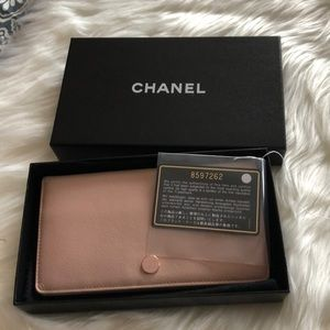 Chanel leather wallet with card and box.